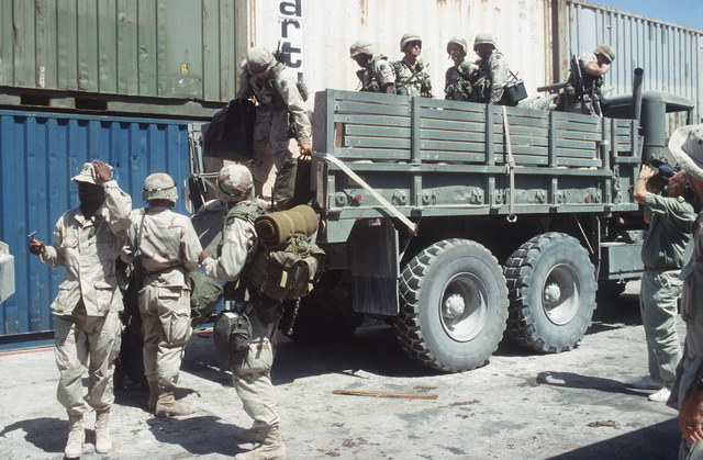 U.S. Army soldiers from the 164th Task Force, Fort Stewart, GA, off load from a M929 5-ton truck after arriving at the port of Mogadishu. The 164th will redeploy to the Military Sealift Command chartered vessel Mediterranean Sky