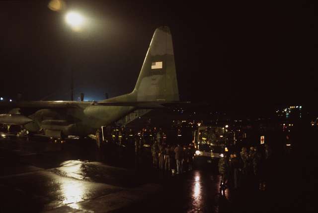 Patients wounded by an exploding mortar round at the Markale market in Sarajevo are removed from the C-130 at Ramstein AB, Germany. Once at Ramstein, the wounded are transported by medical bus to the Army Regional Medical Center in Landstuhl