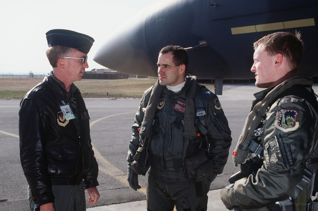 Colonel Dick Brenner, Vice Commander, 401st Fighter Wing, greets Captain Brent Johnson, F-15E pilot, (center) and Weapons Officer, Captain John Harris, on the tarmac just after their arrival
