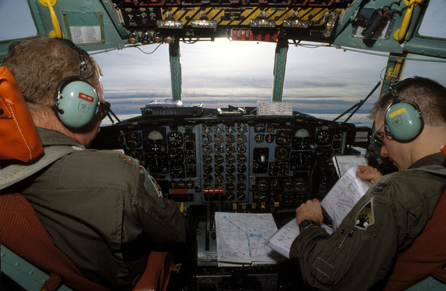 MAJ. Steve O'Brien (left) and CAPT. Carl Lojovich (right) fly a C-130 loaded with food and medicine to Sarajevo. MAJ. O'Brien and CAPT. Lojovich are assigned to the 133rd Airlift Wing, Minnesota Air National Guard, St. Paul, Minn