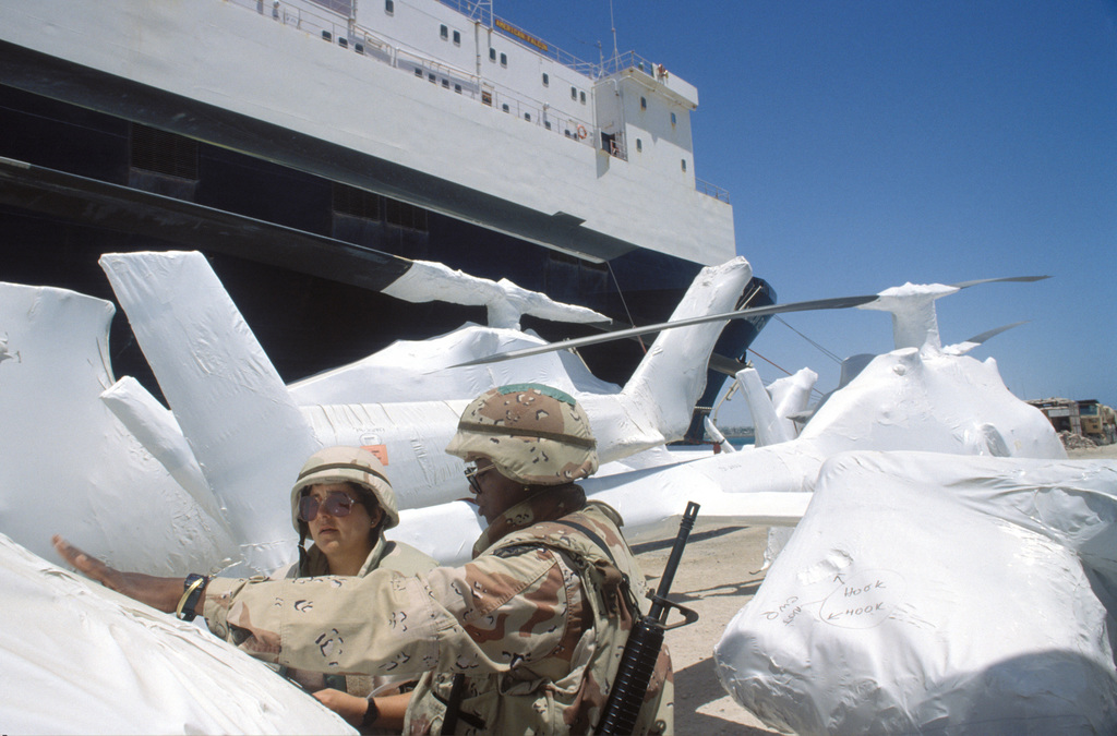 Members of the Army National Guard from five states combined to form a Round Out Unit specializing in Aviation Depot Maintenance. The Army National Guard team trained soldiers from the 4th Aviation, Fort Carson, Colo, on the techniques of shrink wrapping helicopters. The wrapping protects the helicopters from corrosion during shipping