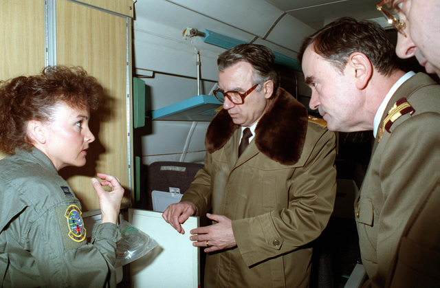 CAPT Sharon Brinsko of the 2nd Aeromedical Evacuation Squadron explains C-9 aircraft seating configurations to MAJ Gen Victor Voicu, Romanian Surgeon General (center) and Romanian Hospital Commander LT. COL. Stefan Leica (right). Ramstein Air Base played host to the Romanian Surgeon General Office as part of the Military to Military Exchange Program