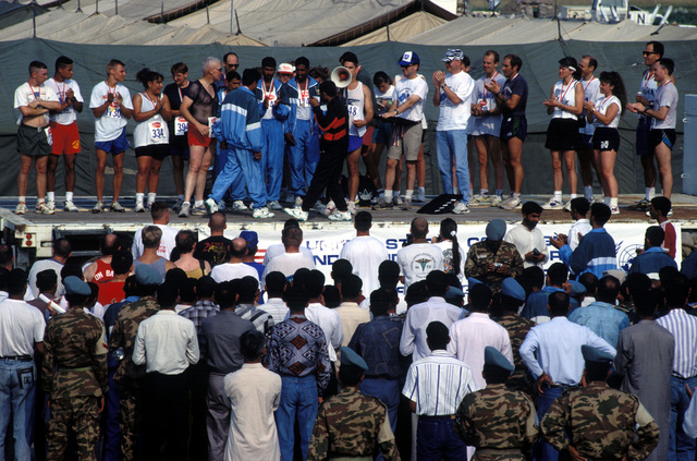 COL. Burton C. Quist, commander Joint Task Force Provide Promise (Forward), US Marine Corps, congratulates all the winners of the Independence Day 5K Fun Run at Camp Pleso