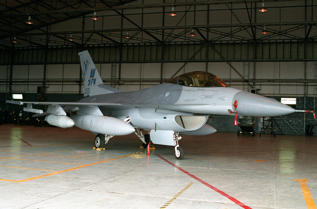 A newly painted F-16 Fighting Falcon stands on display in a hangar awaiting reassignment to the 31st Fighter Wing, Aviano Air Base, Italy. With the deactivation of the 526th Fighter Squadron at Ramstein Air Base, Germany, the 86th Maintenance Squadron repainted the tails of the F-16 aircraft being transferred to Aviano Air Base, Italy