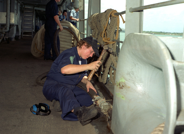 Engineman Fireman Apprentice (ENFA) Michelle L. Smith disconnects the shore based power line as the submarine tender USS HOLLAND (AS-32) completes preparation for getting underway for a 45 day cruise which will include a stop over in Sasebo, Japan