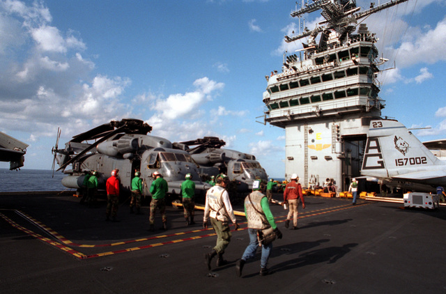 Two U.S. Air Force MH-53J combat search and rescue helicopters from the 20th Special Operations based at Hurlburt Field, Fla. are spotted on elevator #2 on board the nuclear-powered aircraft carrier USS GEORGE WASHINGTON (CVN-73) during the joint special operations Fleet Exercise 2-94