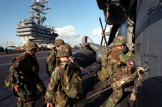 U.S. soldiers of the 75th Special Forces Group embark onto a U.S. Air Force MH-53J combat search and rescue helicopter on the flight deck of the nuclear-powered aircraft carrier USS GEORGE WASHINGTON (CVN-73) during Fleet Exercise 2-94