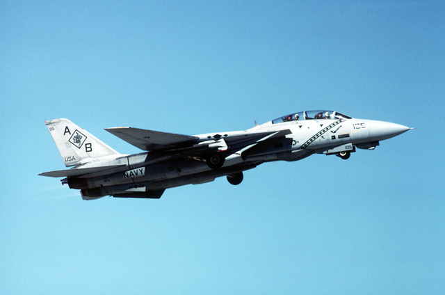 A right side view of an F-14A Tomcat aircraft of Fighter Squadron 102 (VF-102) climbing out after take-off while still pulling up his landing gear. The aircraft is assigned to the aircraft carrier USS AMERICA (CV-66)