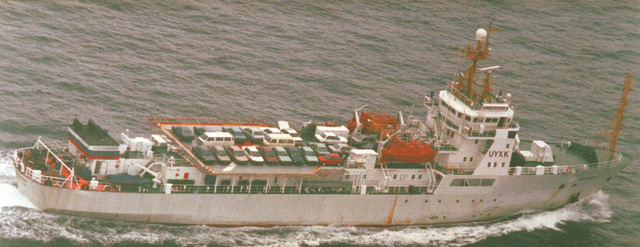 An aerial starboard quarter view of the Russian Ministry of Fisheries protection ship MANCHZHUR underway with a deck cargo of passenger vehicles