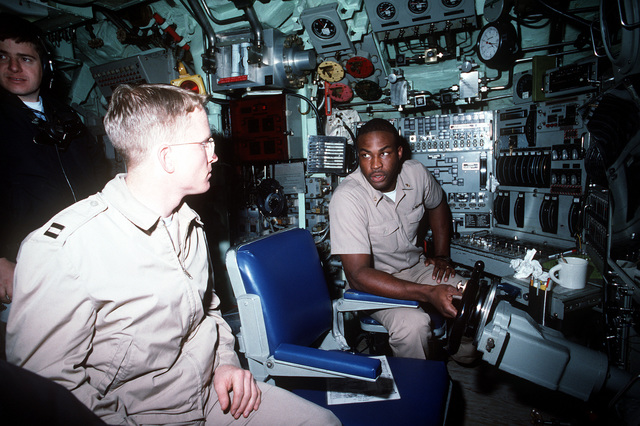 LT. David Post and CHIEF Fire Control Technician (FTC) Clifton Williams stand their watch in the control room of the nuclear-powered attack submarine USS NORFOLK (SSN-714)