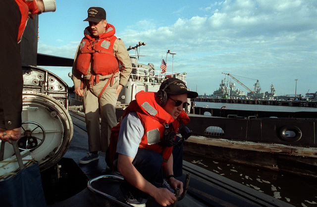 SENIOR CHIEF Sonar Technician (STCS) Peter Manias and SEAMAN (SN) Chad Plambek are shown preparing for the maneuvering watch as the nuclear-powered attack submarine USS NORFOLK (SSN-714), get underway from the Norfolk Naval Base for Annapolis, MD