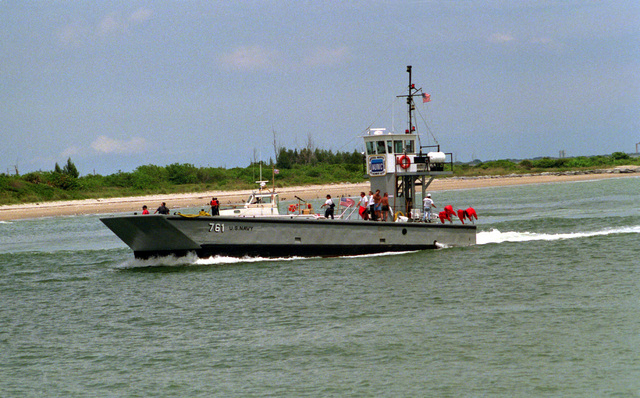 A port bow view of the modified landing craft medium 761 (LCM-761), attached to the Naval Underseas Warfare Center, as the service craft moves up the channel into port