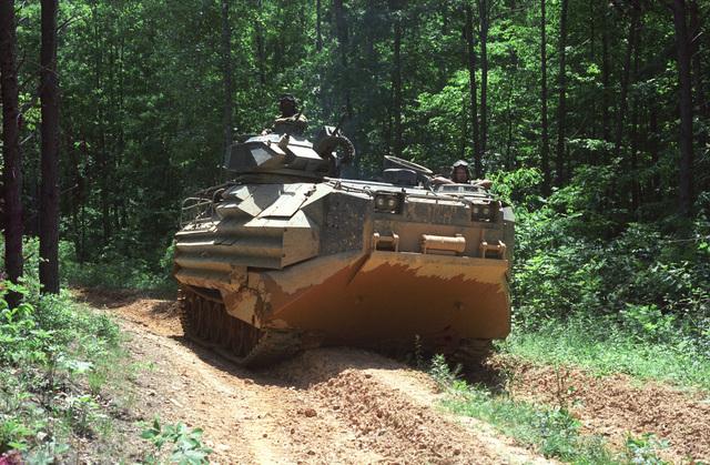 An Assault Amphibian Vehicle (AAV7A1) from the CLNCs 2nd AAV Battalion moves along a Wilderness Road