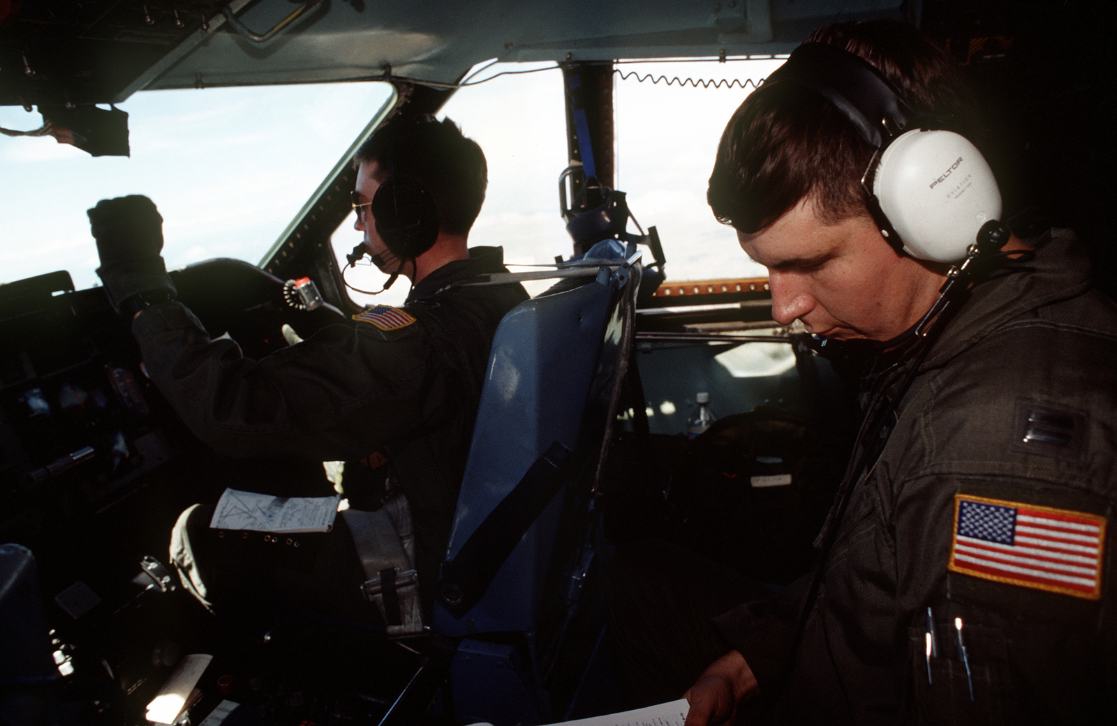 Interior view of cockpit as LT. Lance Devin, co-pilots the C-141B, from the 438th Airlift Wing, McGuire Air Force Base, NJ, and CAPT. Eric Block as an Observer, in flight