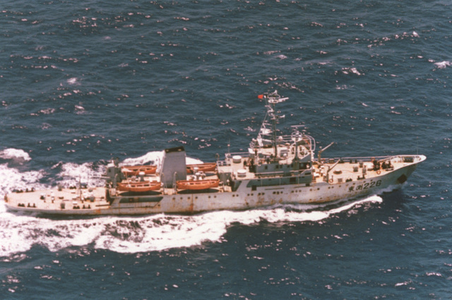 An aerial starboard side view of the Chinese Navy Yan Lai class survey ship DONG BIAO 226 underway