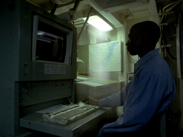 Aerographer AIRMAN (AGAN) Felipe Montford inputs a forecast for a weather brief from the Meteorological Center on board the nuclear-powered aircraft carrier USS THEODORE ROOSEVELT (CVN-71)