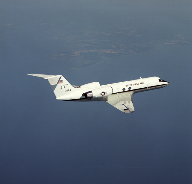 A right rear view of the new C-206 Gulfstream IV transport aircraft in flight near the Naval Air Warfare Center at the Naval Air Station. This is the first of five aircraft for the Navy. One additional aircraft will go to the Marine Corps