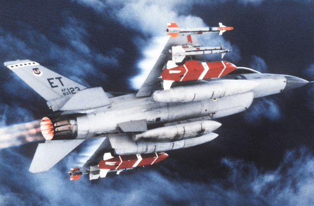 An air-to-air underside view of an F-16 Fighting Falcon (tail #123) with weapons. On the wingtips are AIM-9P Sidewinder missiles, next are AIM-9M Sidewinder missiles, and then a Dispenser Weapons System 39 (DWS). The DWS is fitted with an on-board computer and a radar altimeter and is guided automatically to the target by data transmitted from the aircraft