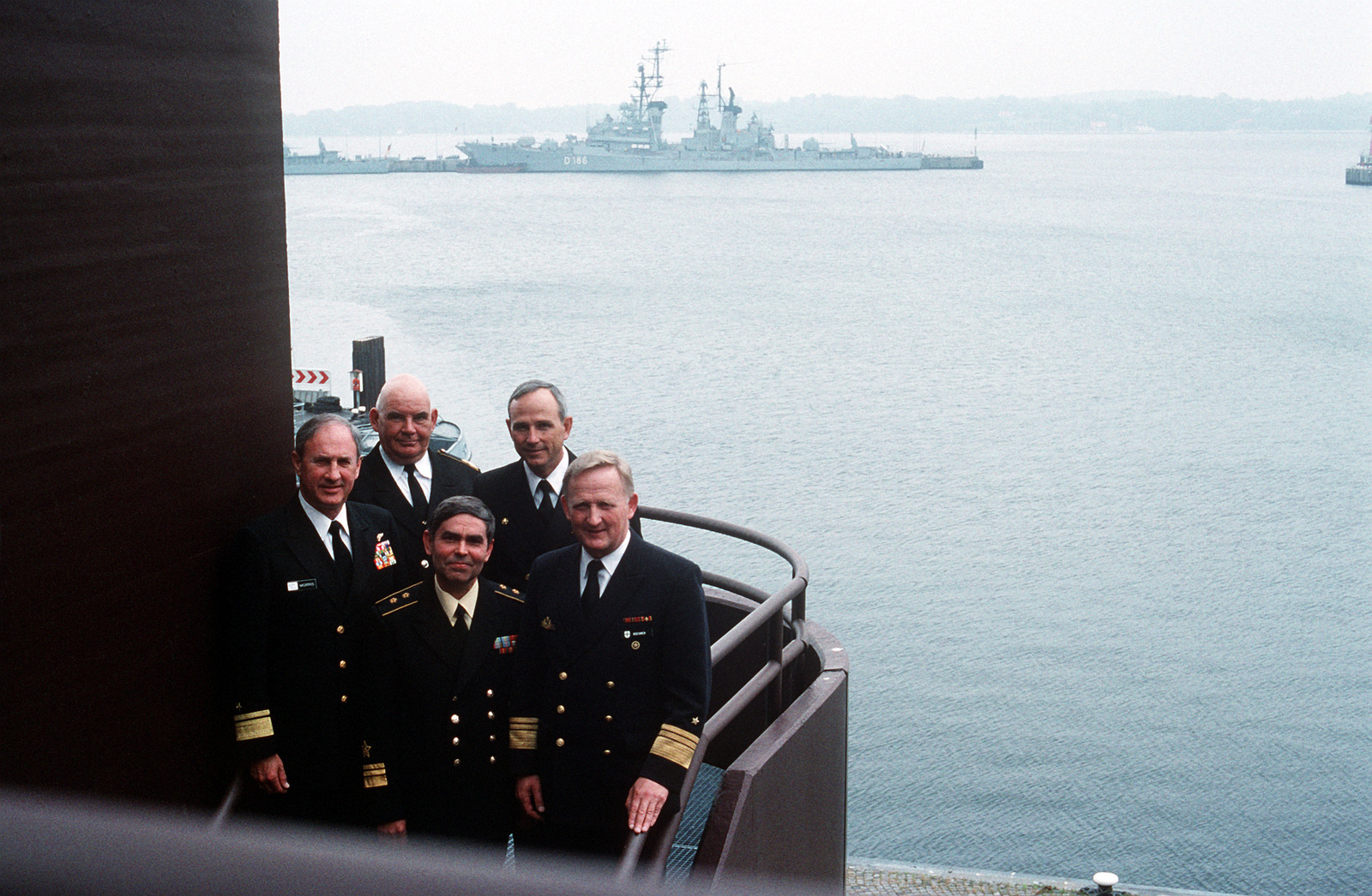 Several officers involved at a BALTOPS 94 press conference pose together on a stair case at the German Naval Officers Club. The officers include (from left) Rear Admiral David R. Morris, Deputy Commander in CHIEF, U.S. Naval Forces Europe, Commodore Ralmundas Baltuska, Commander Lithuanian Naval Flotilla, Russian Vice Admiral Victor Litinov, Deputy Commander in CHIEF Baltic Fleet, Captain Edward E. Hunter, Commander Destroyer Squadron 14, and Vice Admiral Boehmer, Commander in CHIEF German Fleet