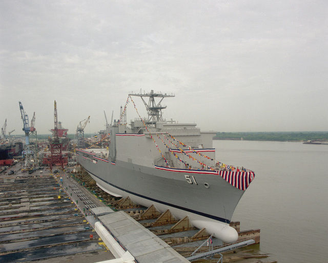 A starboard bow view of the dock landing ship OAK HILL (LSD-51) resting on the forward poppets of the launching ways shortly before the ship's official christening at the Avondale Industries, Inc. Shipyard