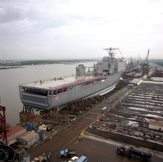 A starboard quarter view of the dock landing ship OAK HILL (LSD-51) resting on the aft poppets of the launching ways at the Avondale Industries, Inc. Shipyard shortly before the ship's official christening