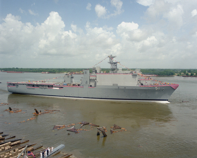 A starboard side view of the dock landing ship OAK HILL (LSD-51) floating free in the Mississippi River at the conclusion of the ship's christening ceremony at the Avondale Industries, Inc. Shipyard