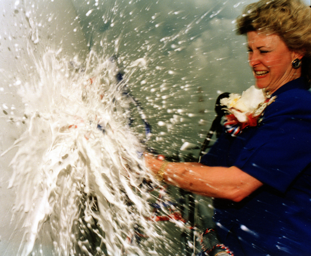 In a blast of foam, Mrs. Sandra Boomer breaks the traditional bottle of champagne across the bow of the dock landing ship OAK HILL (LSD-51) officially christening the newest amphibious shp of the U.S. Navy in ceremonies at the Avondale Industries, Inc. Shipyard