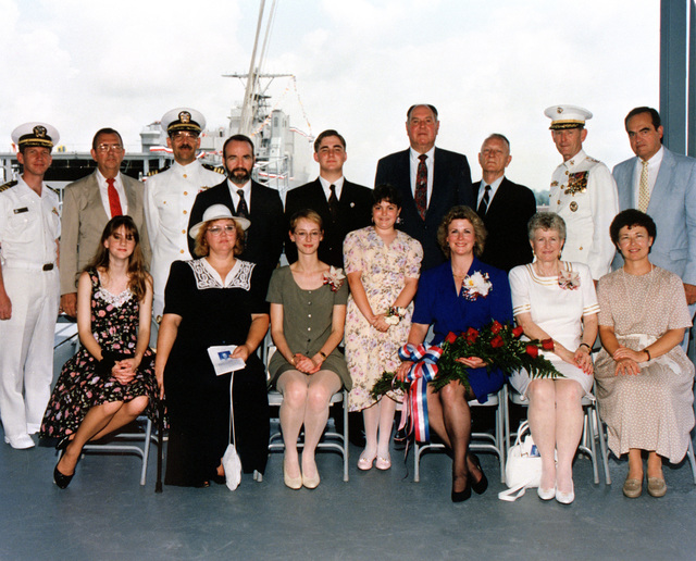 Informal portrait of the principal members of the christening party of the dock landing ship OAK HILL (LSD-51). (Top row, L-R); CDR. Mike Durnan, prospective CO of LSD-51. Ed Mortimer, Vice Pres. Avondale Industries; CDR. J. Larry Perry; Bernard P. Clark; Jacob Perin; J.D. Lokey; Eugene E. Shoults; General Walter E. Boomer, USMC; and Albert L. Bossier, Jr., CEO Avondale Industries. (Bottom row L-R); Victoria Perin, Mrs. Jeffrey Perin; Miss Helen Boomer, Maid of Honor; Miss Falyn Amada Dempster, Flower Girl; Mrs. Sandra Boomer, Sponsor; Mrs. J.D. Lokey, Matron of Honor and Mrs. Diana Perry