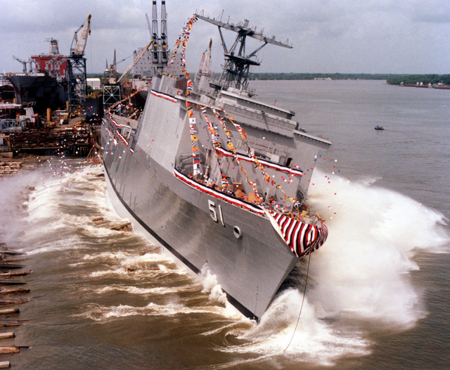 With a surge of white water, the dock landing ship OAK HILL (LSD-51) splashes into the Mississippi River at the conclusion of the ship's christening ceremony at the Avondale Industries, Inc. Shipyard