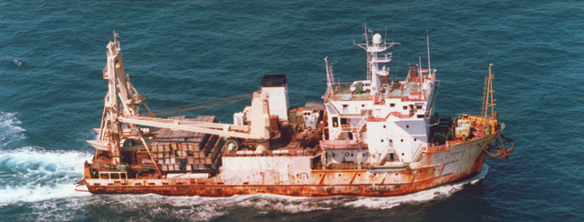 An aerial starboard side view of the Russian research ship TRIAS underway carrying commercial cargo in the Western Pacific area