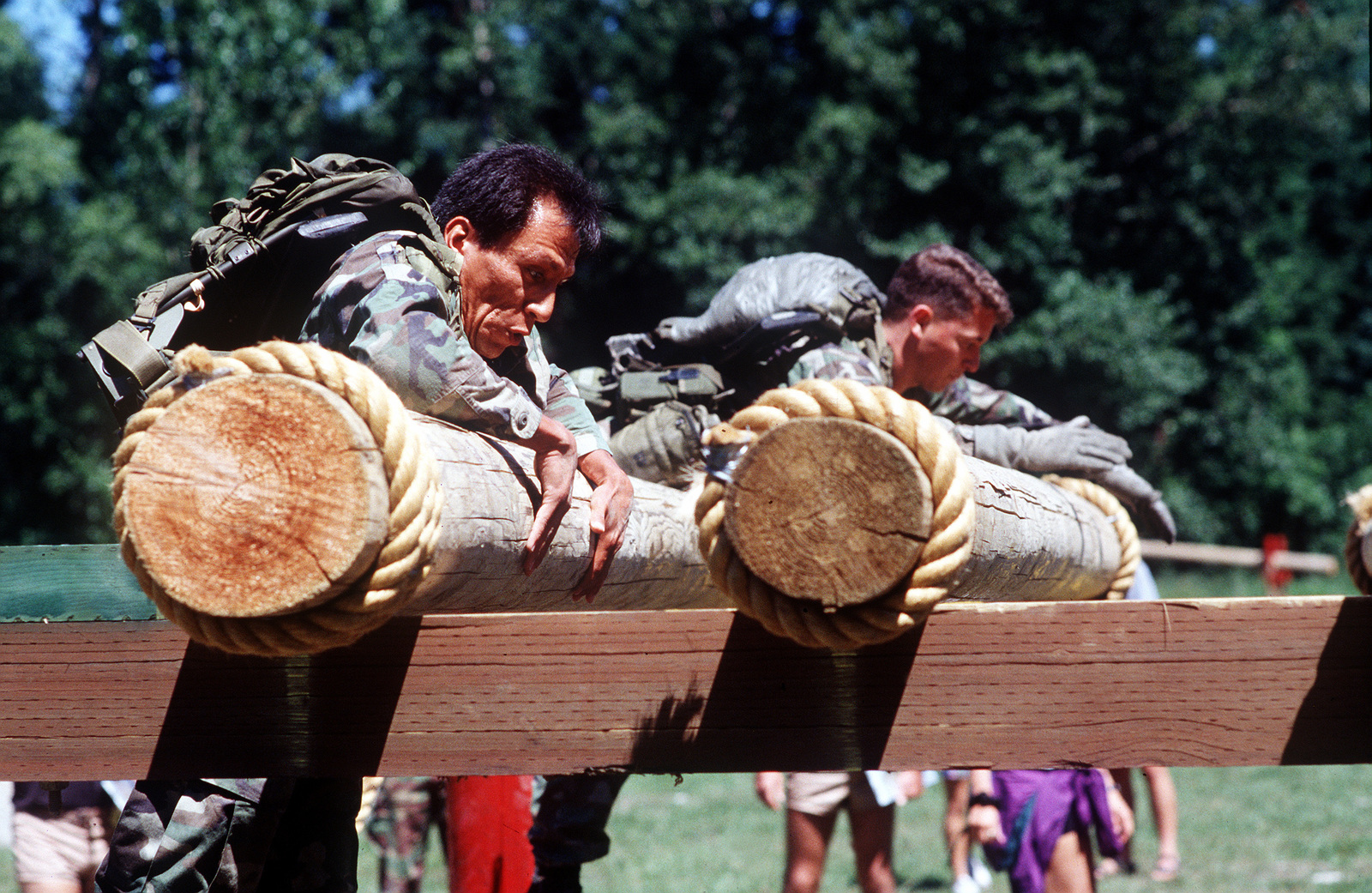 United States Air Force Combat Controllers deployed from the 58th Special Operations Wing, Kirtland Air Force Base, New Mexico, compete against other combat control teams in the grueling obstacle course during the annual mobility competition, RODEO '94 held at McChord Air Force Base, Washington