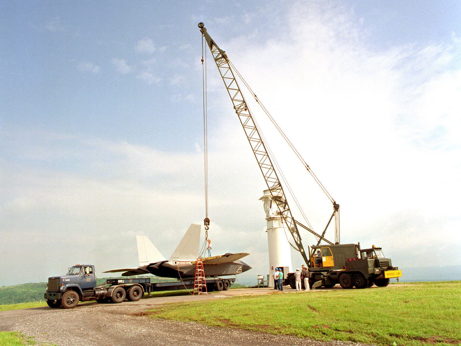 A crew assigned to Rome Laboratory's Newport, NY test site prepares to hoist a modified YF-22 airframe to a pedestal for antenna measurement tests. During initial testing, over 400,000 antenna measurements will be taken