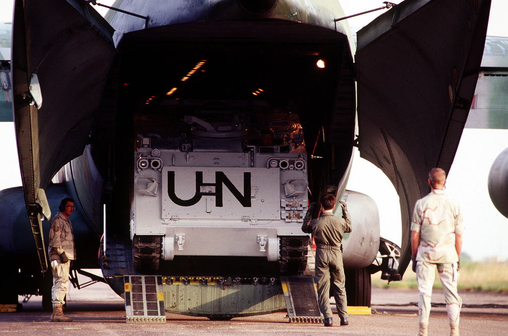 An M-113A2 rolls out of a USAF C-141 Starlifter and onto the ramp at the airport near Kampala, Uganda. The 62nd Airlift Wing, McChord AFB, WA., delivered the M-113A2 which was one of the first to be delivered to United Nations troops in Uganda for use in the peacekeeping efforts underway in neighboring Rwanda