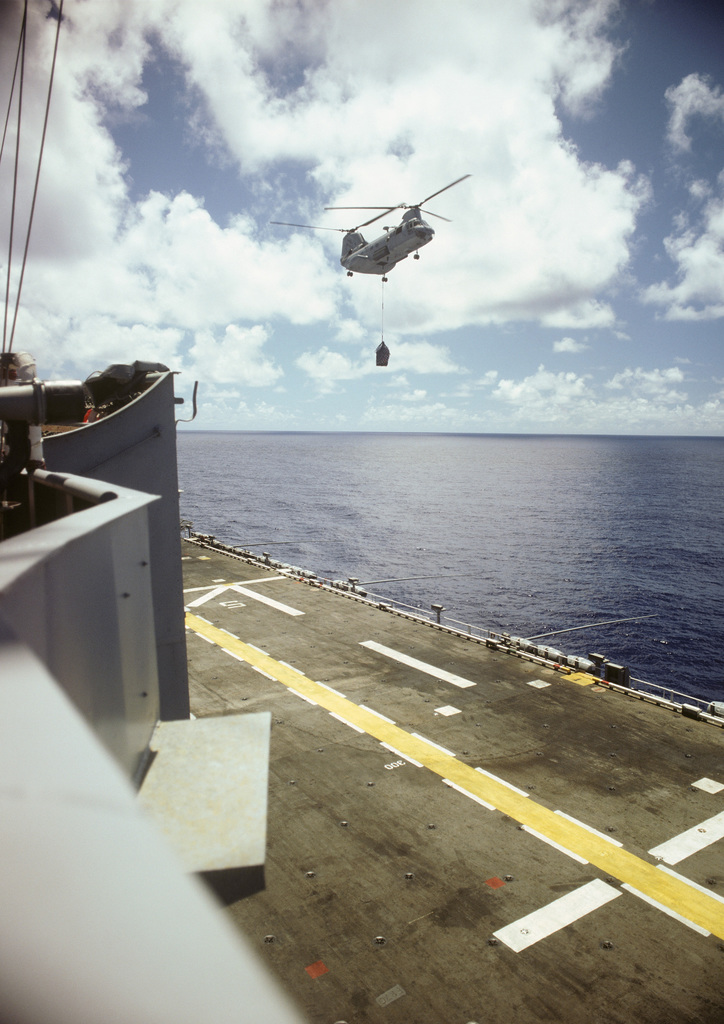 A CH-46 Sea Knight helicopter of Composite Helicopter Squadron Detachment 4 approaches the amphibious assault ship USS TRIPOLI (LPH-10) during a vertical replenishment (VERTREP). The pilot of the helicopter is LT. Susan Marshall, assigned to USNS NIAGARA FALLS (T-AFS-3)