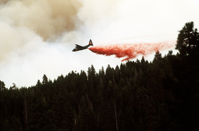 Modular Airborne Fire Fighting System 2 lays Phoschek retardant in front of the advancing Bannock Fire