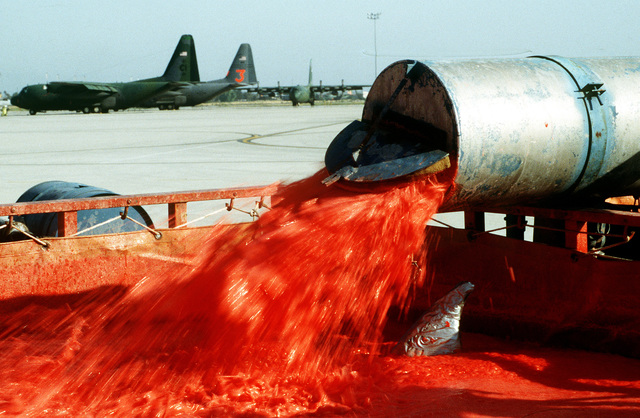 The powdered Phoschek retardant is mixed with water prior to pumping it into Air National Guard and Air Force Reserve C-130 aircraft at the Sky Harbor Airport