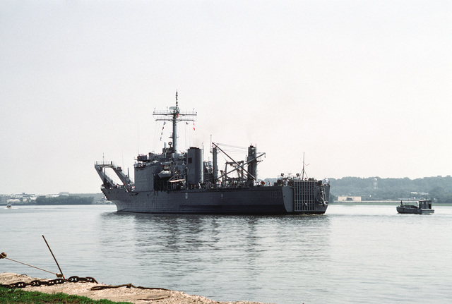 A port quarter view of the tank landing ship USS FAIRFAX COUNTY (LST-1193) on the Potomac River arriving at Alexandria, VA for a port visit to the ship's namesake, Fairfax County. This is the last visit before the ship is transferred to the Australian Navy later this month
