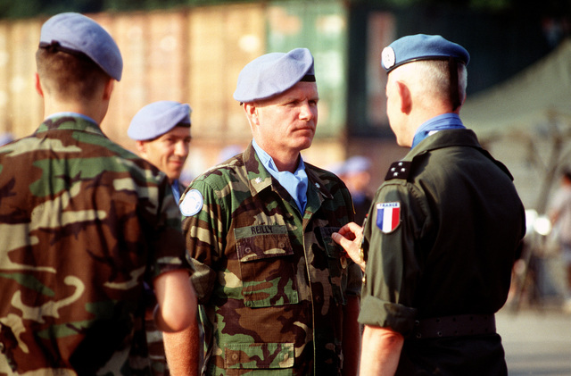 Commander of Joint Task Force Provide Promise (JTFPP) (Forward), COL. Burton C. Quist, US Marine Corps, receives his United Nations (UN) Medal from Lieutenant-General Bertrand Guillaume de Lapresle, Force Commander, UN Protection Forces at the JTFPP (Forward) UN Medals Parade, Camp Pleso