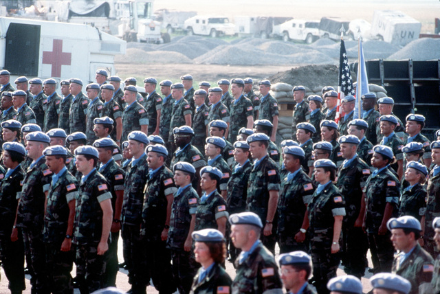 Soldiers, Sailors, Marines and Airmen of Joint Task Force Provide Promise stand in formation while the colors are being presented. They are being awarded the United Nations Medal for Service for the period of March 1994 through July 1994. The United States contingent provided critical humanitarian and medical aid to the people of the former Republic of Yugoslavia