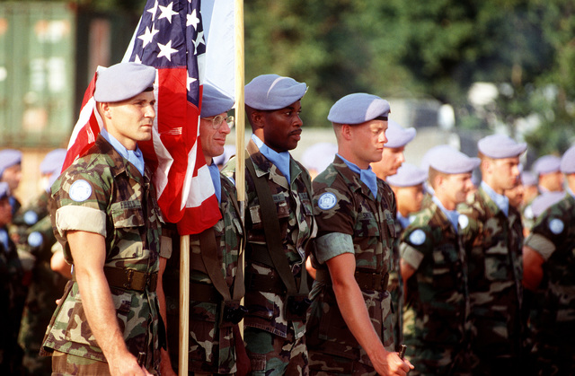 The Colors are carried in the Joint Task Force Provide Promise (Forward) United Nations Medals Parade, Camp Pleso, by LCPL. Steve Wade, SGT. Joseph Middlebrooks, and LCPL. David Smith. All are US Marine Corps military police stationed at Camp Lejeune, NC
