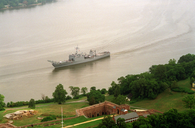 An aerial port bow view of the tank landing ship USS FAIRFAX COUNTY (LST-1193) passing under the ramparts of Fort Washington en route to the ship's homeport of Little Creek, Va. where the vessel is scheduled to be transferred to the Australian Navy