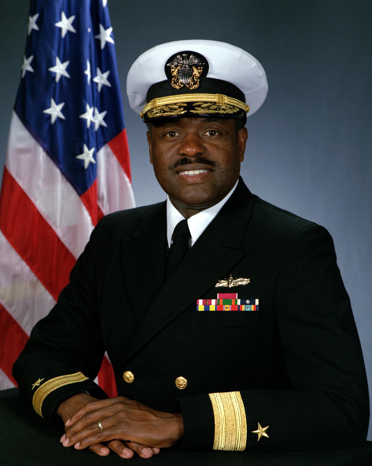 Rear Admiral (lower half) David L. Brewer, III, USN