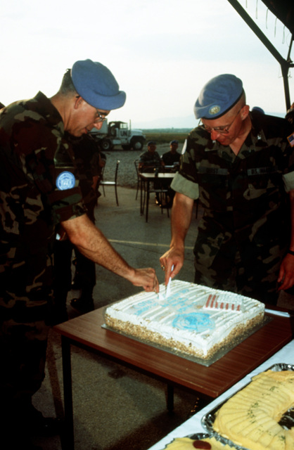 COL. Allen Gardner, U.S. Army, the new Joint Task Force Provide Promise (JTFPP) (Forward) Commander and Colonel Burton Quist, U.S. Marines, out going Commander JTFPP (Forward) cut a commemorating cake as refreshments are served after the JTFPP (Forward) Change of Command ceremony, Camp Pleso