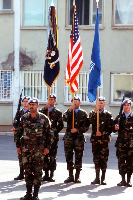 The 2/15 Battalion Color Guard from Schweinfurt, Germany, holds the colors during the review of the troops by the US Secretary of Defense William J. Perry at Camp Able Sentry
