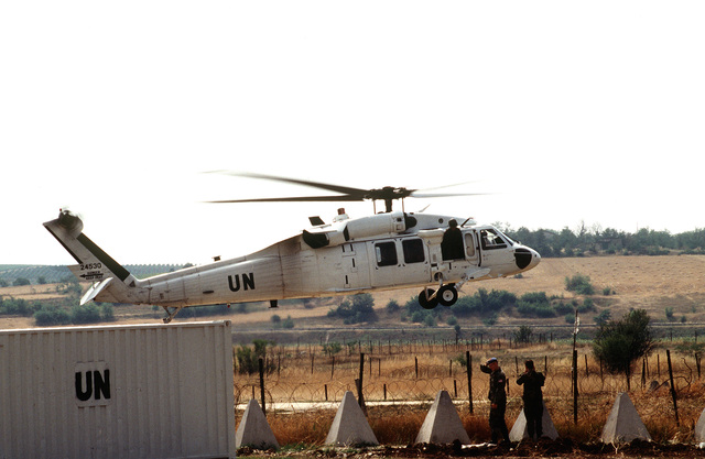 US Secretary of Defense William J. Perry departs from Camp Able Sentry on a UH-60 helicopter for an Observation Post site