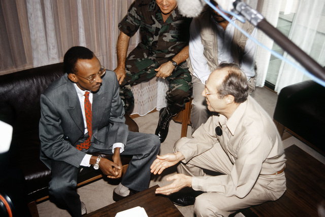 United States Secretary of Defense William Perry discusses the Rwandan civil war and refugee situation with Rwandan President Paul Kagami during the secretary's visit to Kigali