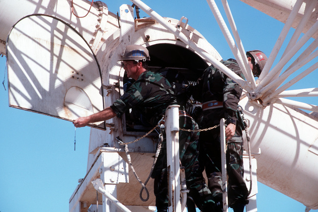 TECH. SGT. Dave Stapchuck and MASTER SGT. Ray Coffman check the 28-foot-diameter radio telescope. The two are assigned to Detachment 1, 50th Weather Squadron at Learmonth, Australia, which, along with six other Air Weather Service solar observatories around the globe, monitors solar activities 24 hours a day. Exact Date Shot Unknown .Published in AIRMAN Magazine November 1994
