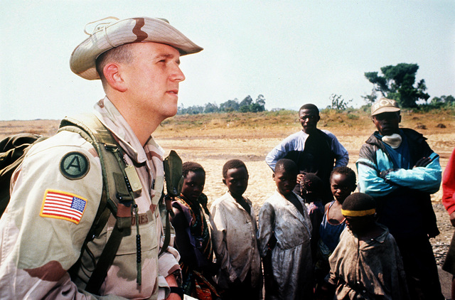 CAPT. Mike Jones from the Visual Information Support Center (National Guard), Nashville, Tenn., is surrounded by curious Rwandan refugees