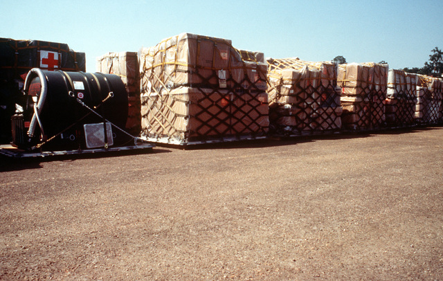 Pallets of medical supplies remain packaged until the field hospital being built by members of the 86th Medical Group Ramstein Air Base, Germany, is completed