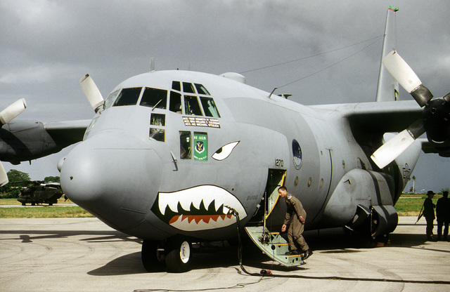 A crewmember boards a C-130 Hercules from the 41st Airlift Squadron, Pope AFB, North Carolina parked on the crowded Moi International Airport flight line. The C-130s are part of the United States contingent providing humanitarian relief to Rawanda and Uganda
